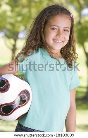 young girl holding football - stock photo