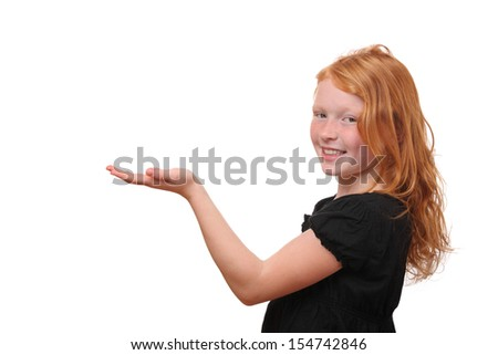 Young girl holding hand presenting a product on white background - stock photo