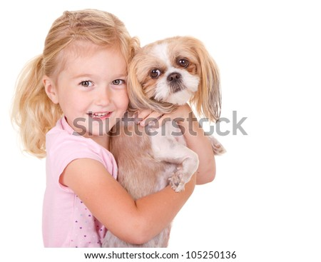 young girl holding her pet dog shih tzu, isolated on white - stock photo
