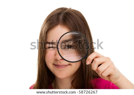 Young girl holding magnifying glass - stock photo