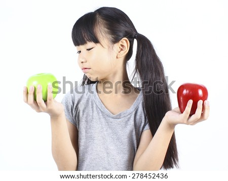 Young girl holding red and green apple - stock photo