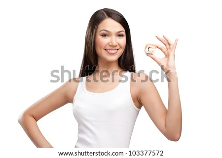 Young girl holding sushi in her hand and smiling, isolated on white on white - stock photo