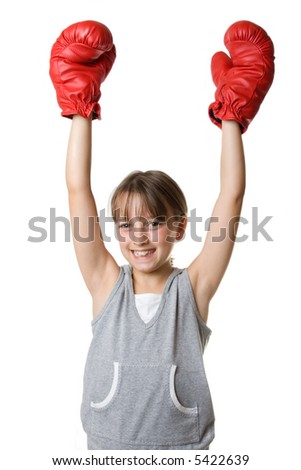 Young girl holding up her arms to celebrate victory