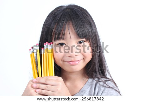 Young girl holding yellow pencils - stock photo