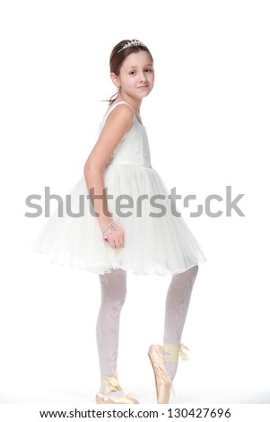 Young girl in a dancing costume and pointe