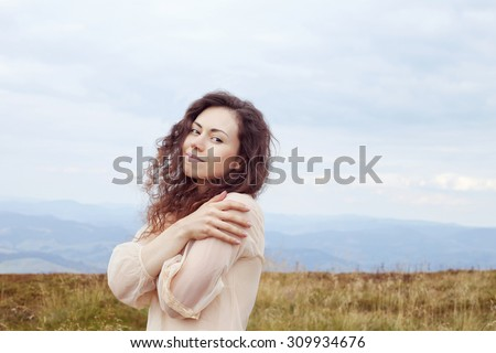 Young girl in a dress. Mysterious woman, nymph, muse. Tenderness, beauty. Girl on a walk in the mountains. Mountain ridges of the Carpathians. Carpathian mountains. - stock photo