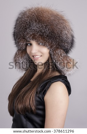 Young girl in a hat. Natural fox fur. - stock photo