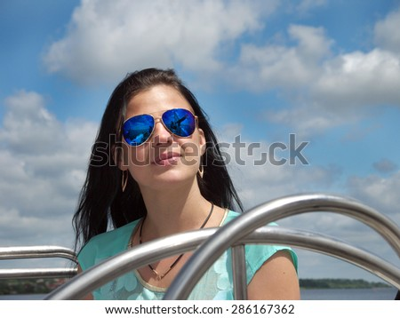 young girl in a  mirrored, blue sunglasses - stock photo