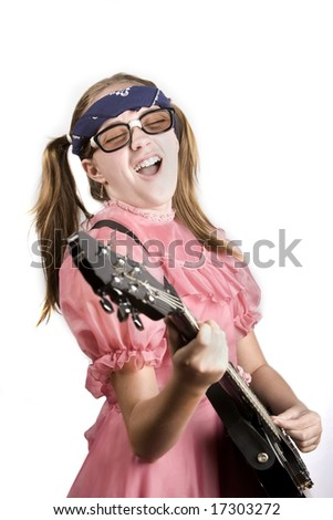 Young girl in a pink dress with an electric rock guitar