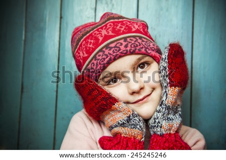 young girl in a red cap, portrait. - stock photo