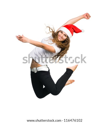 young girl in a Santa Claus hat jump - stock photo