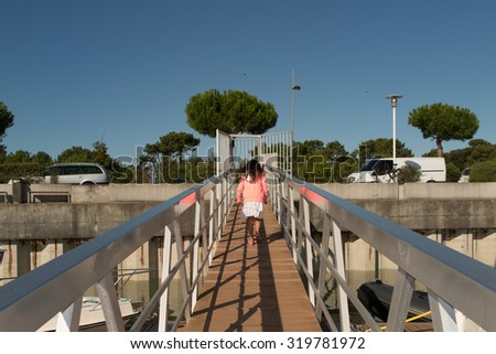 Young girl in an harbour on holidays