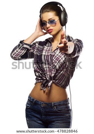 Young girl in blue jeans with headphones isolated