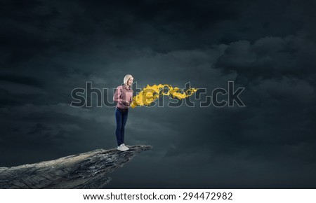 Young girl in casual splashing colorful paint from bucket - stock photo