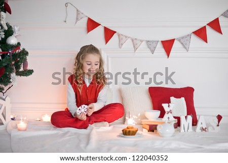 Young girl in christmas at home - stock photo