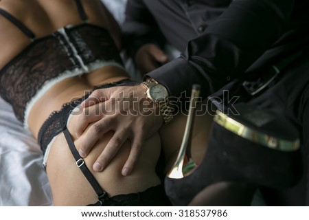 young girl in erotic lingerie with a man