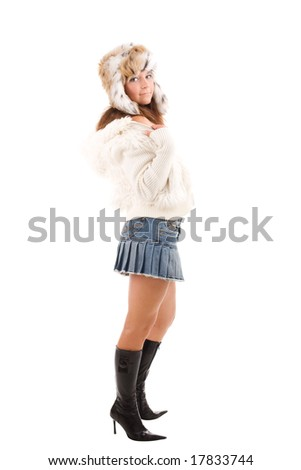 Young girl in fur cap with ear-flaps