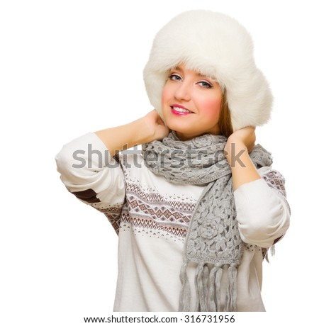 Young girl in fur hat isolated - stock photo