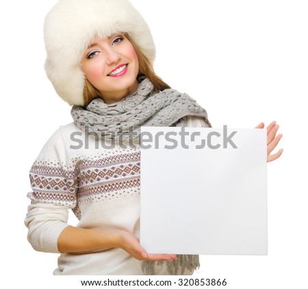 Young girl in fur hat with empty card isolated
