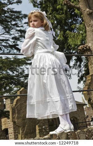 Young girl in her white communion dress - stock photo