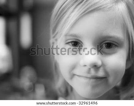 Young girl in kitchen looking at camera - stock photo
