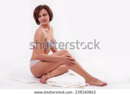 Young girl in lingerie over white background - stock photo