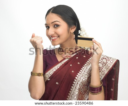 Young girl in red silk sari with credit-card - stock photo