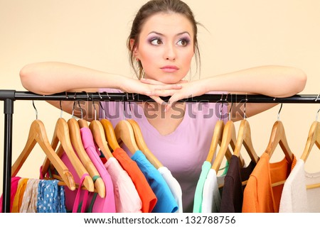 Young girl in shop buying clothes - stock photo