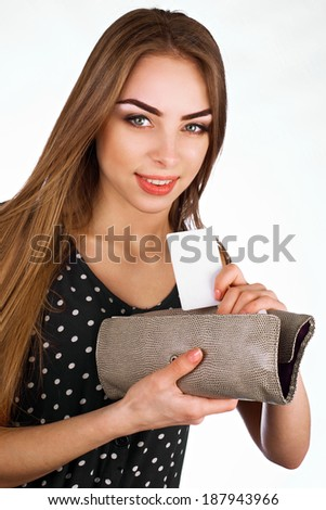 Young girl in the hands purse and bank card