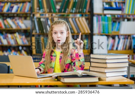 young girl in the library showing finger up