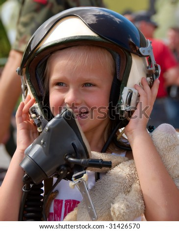 young girl in the pilot helmet - stock photo