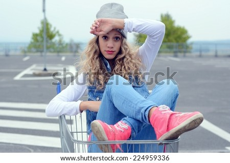 Young girl in the shopping cart
