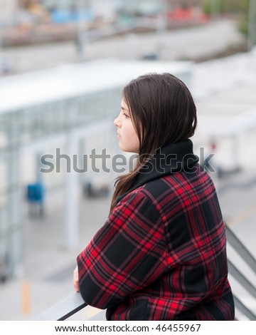 Young girl in transit center. Shallow depth of field.