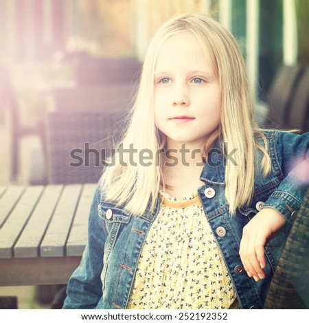 Young girl in vintage european coffee shop