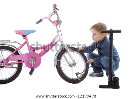 Young girl inflate wheel her bike isolated on white - stock photo