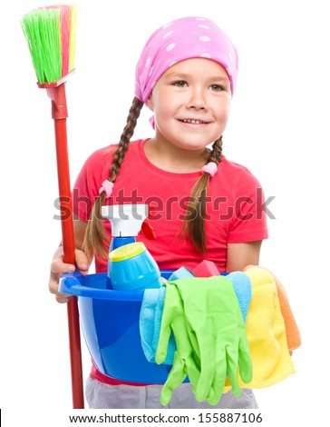 Young girl is dressed as a cleaning maid, holding broom and bucket full of liquids, isolated over white - stock photo
