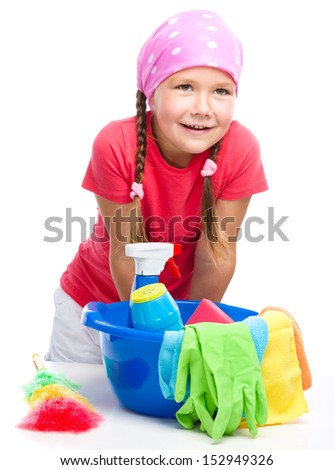 Young girl is dressed as a cleaning maid with bucket full of liquids, isolated over white - stock photo