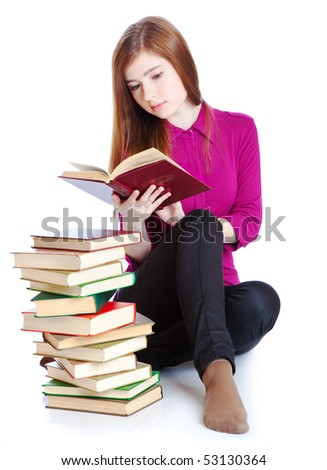 Young girl is sitting on a floor and reading book. Isolated on white background - stock photo