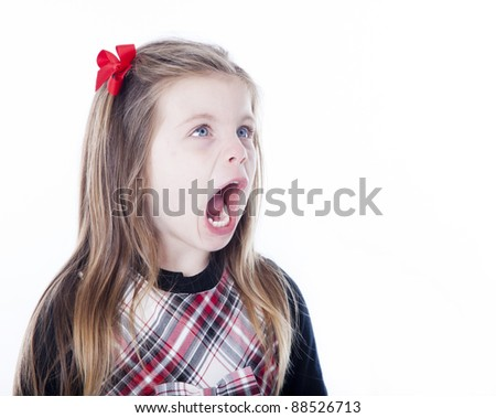 Young girl isolated on white with her mouth open looking to side - stock photo