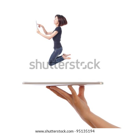 Young girl jump and using tablet pc on a people hand isolated on white background, model is a asian beauty - stock photo