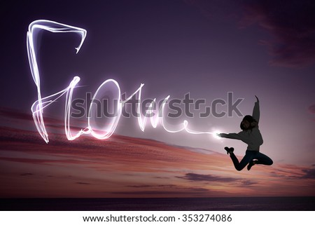 Young girl jumping high in sky and draw happiness concept