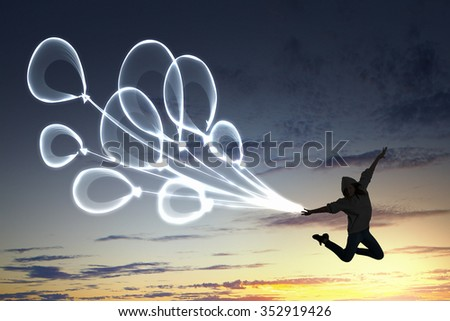 Young girl jumping high in sky representing happiness concept