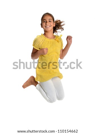 Young girl jumping isolated over white background - stock photo
