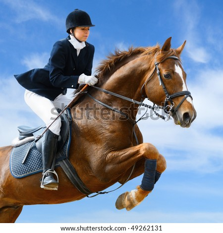 Young girl jumping with sorrel horse