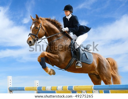 Young girl jumping with sorrel horse - stock photo