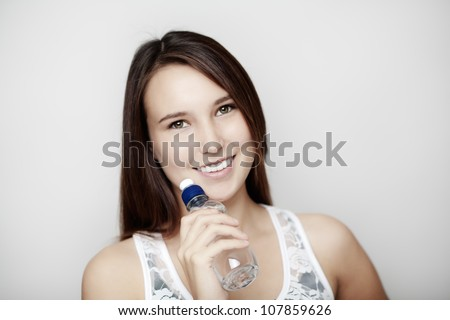young girl keeping hydrated with a bottle of water - stock photo