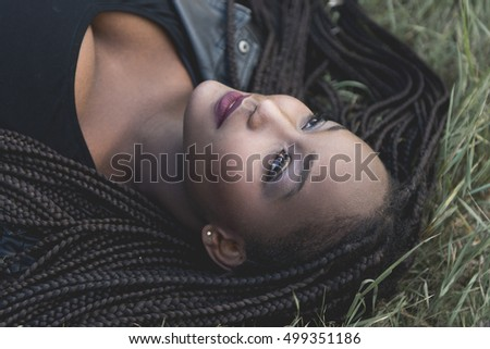 Young girl laying on grass with long hair