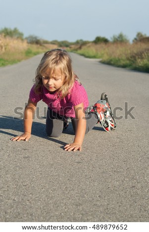 young girl learning to skate on inline roller skates