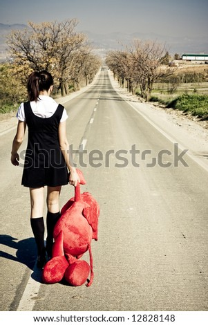 Young girl left behind with her teddy bear. - stock photo
