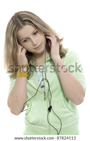Young girl listen a musuc in earphone on